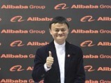 alibaba-founder-and-chairman-jack-ma-poses-for-media-while-touring-the-cebit-trade-fair-in-hanover-2-2
