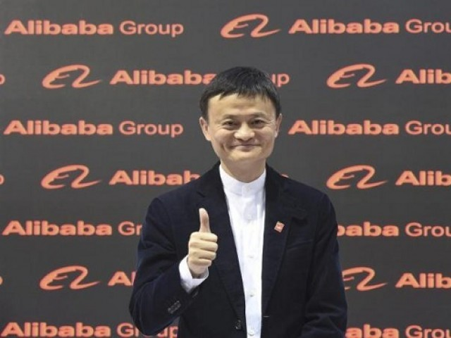 FIle Photo: Alibaba founder and chairman Jack Ma poses for the media while touring the CeBIT trade fair in Hanover March 16, 2015.  PHOTO: REUTERS