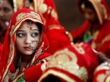 brides-sit-and-wait-for-their-turn-during-a-muslim-mass-wedding-in-ahmedabad