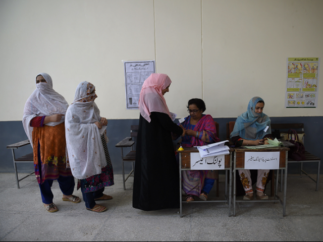 Women line up to vote in the 2018 General Elections. PHOTO:AFP
