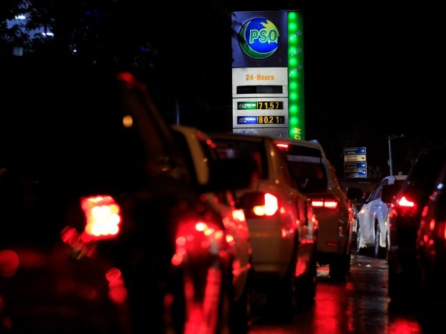 Cars queue at a PSO pump. PHOTO: AFP