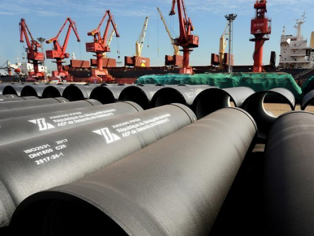 Steel pipes to be exported are seen at a port in Lianyungang Jiangsu province China