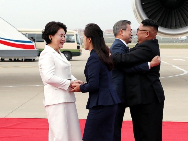 North Korean leader Kim Jong Un and his wife Ri Sol Ju greet South Korean President Moon Jae-in and First Lady Kim Jung-sook at Pyongyang Sunan International Airport, North Korea ahead of the third summit with North Korean leader Kim Jong Un in this still frame taken from video September 18, 2018. PHOTO: REUTERS