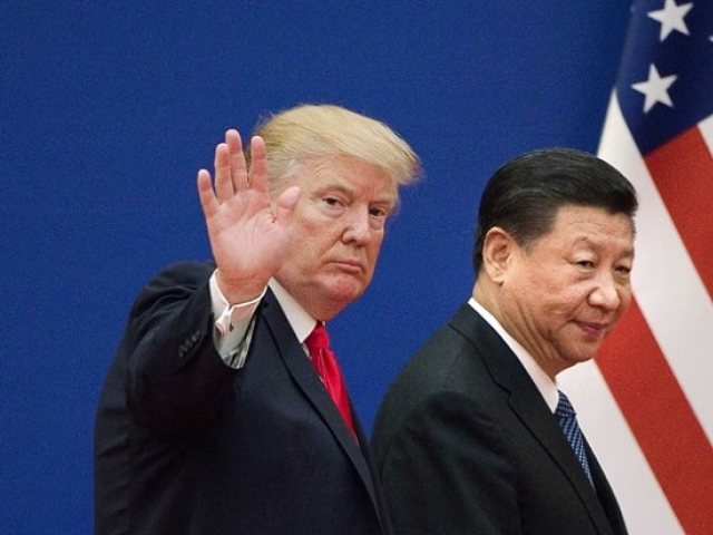 In this file photo taken on November 9, 2017 shows US President Donald Trump (L) and China's President Xi Jinping leaving a business leaders event at the Great Hall of the People in Beijing. PHOTO: AFP