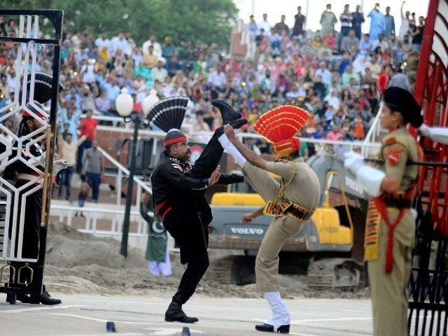 In this file photo, Indian and Pakistani border guards take part in the nightly ceremony at the Wagah border. PHOTO: AFP