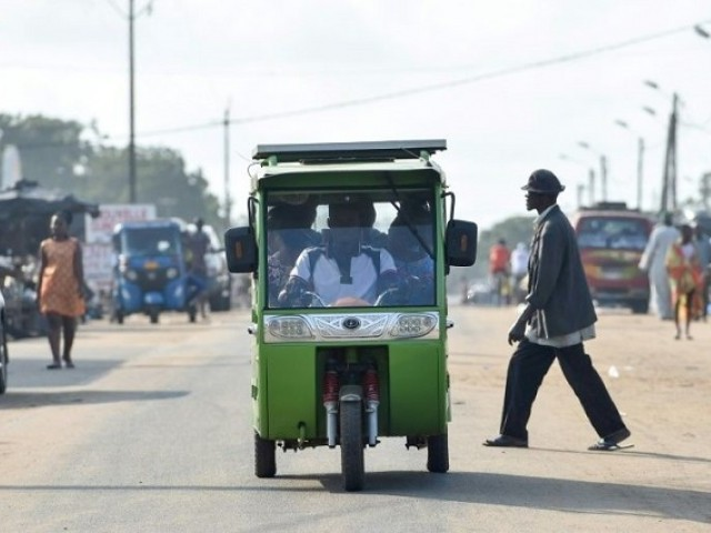 Local politicians are putting great faith in Chinese-made tricycle taxis with rechargable solar energy panels which have been plying routes in Jacqueville, a coastal town outside Abidjan. PHOTO AFP