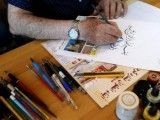 mahmoud-bayoun-a-lebanese-calligrapher-paints-koran-versus-as-he-sits-in-his-office-in-beirut-lebanon-2