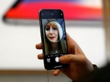 file-photo-a-customer-uses-the-new-face-recognition-software-on-the-new-iphone-x-inside-the-apple-store-in-regents-street-in-london-3