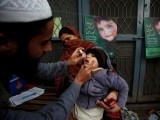 a-boy-receives-polio-vaccine-drops-at-a-government-childrens-hospital-in-peshawar-2-2-2