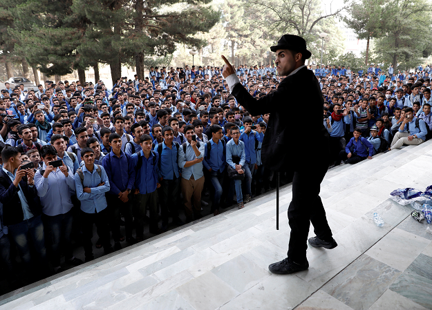 Afghanistan's Charlie Chaplin, Karim Asir 25, performs at a school in Kabul. PHOTO: REUTERS
