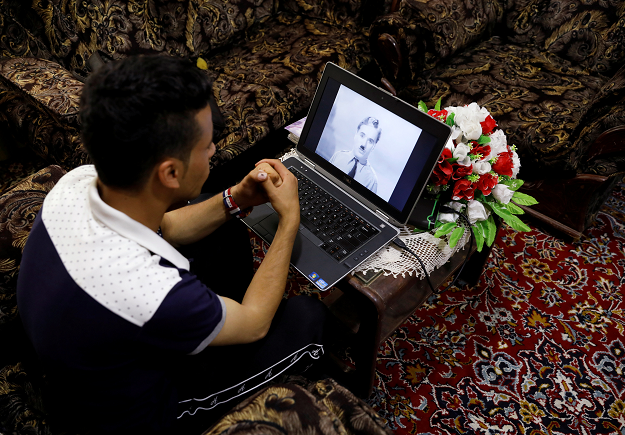 Karim Asir, 25, watches a Charlie Chaplin movie in Parwan province. PHOTO: REUTERS