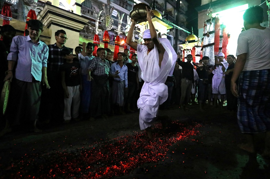 Shia Muslims walk on hot coals during the Ashura festival at a mosque in central Yangon, Myanmar on September 18, 2018. PHOTO:AFP