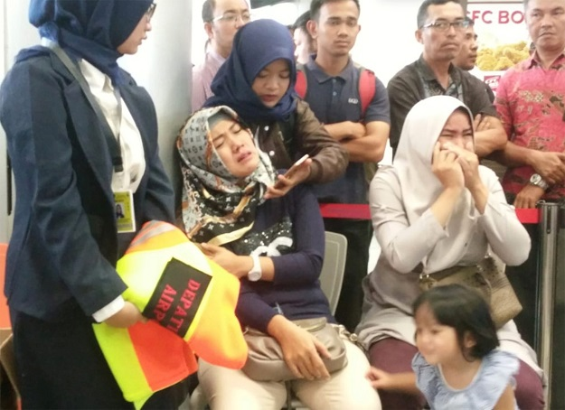Relatives of passengers of Lion Air flight JT610 that crashed into the sea, cry at Depati Amir airport in Pangkal Pinang, Indonesia. PHOTO: REUTERS