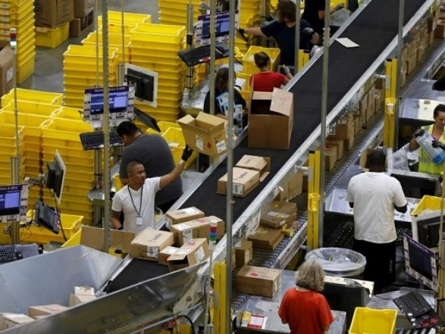 Workers sort arriving products at an Amazon Fulfilment Center in Tracy, California August 3, 2015. PHOTO: REUTERS