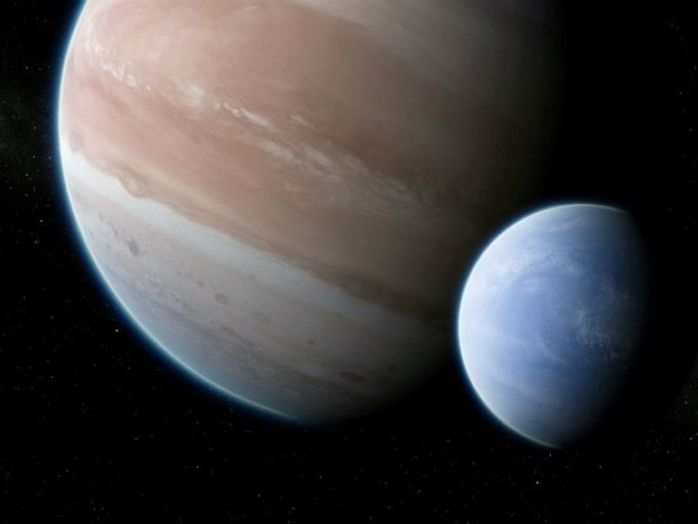 An artist's impression of the exoplanet Kepler-1625b transiting the star with the newly discovered exomoon in tow is shown in this image released