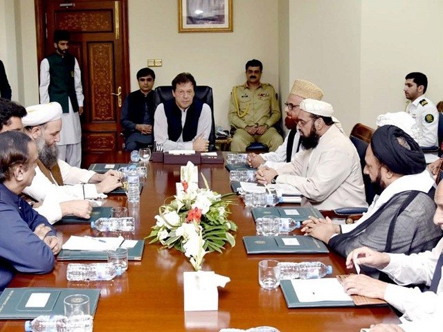 Premier Imran Khan meets prominent clerics of the country to discuss reforms for religious seminaries at the PM Office  on Wednesday. PHOTO: PPI