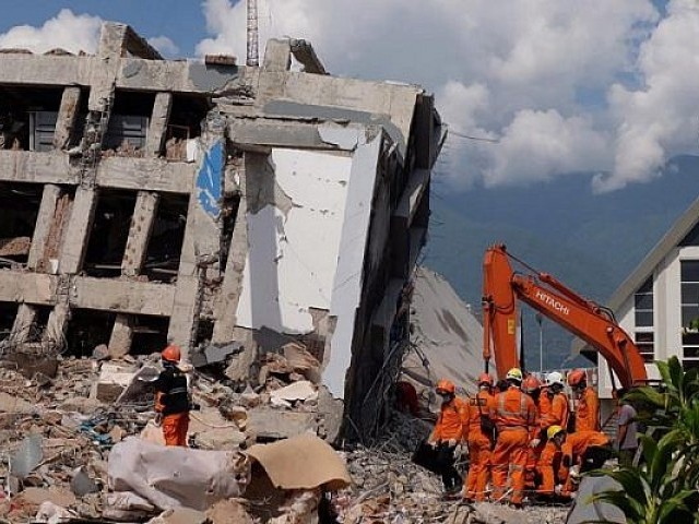 French say no more signs of life in Indonesia hotel rubble