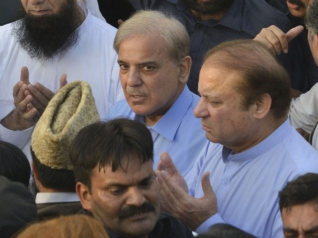 The Sharif brother's at the funeral for Nawaz's wife Kulsoom. PHOTO:AFP