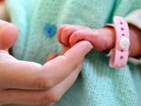 a-newborn-baby-holding-th-012-2-2-3-3-2