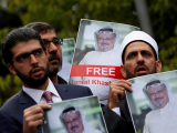human-rights-activists-and-friends-of-saudi-journalist-jamal-khashoggi-hold-his-pictures