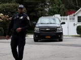 file-photo-law-enforcement-stands-outside-the-gatehouse-of-bill-and-hillary-clintons-house-in-chappaqua