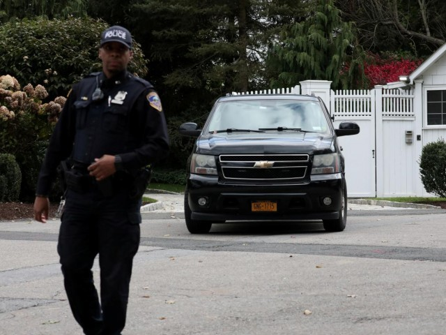 Law enforcement stands outside the gatehouse of Bill and Hillary Clinton's house in Chappaqua, New York, US. PHOTO REUTERS