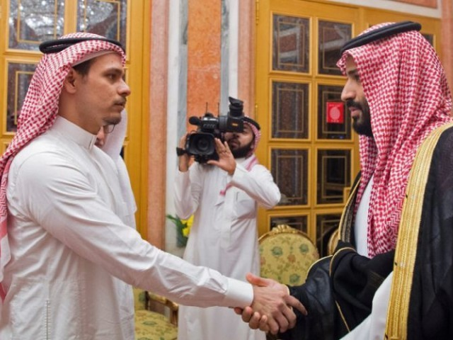 Saudi Crown Prince Mohammed bin Salman meets relatives of murdered Saudi journalist Jamal Khashoggi in a handout