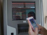 a-message-demanding-money-is-seen-on-a-monitor-of-a-payment-terminal-at-a-branch-of-ukraines-state-owned-bank-oschadbank-after-ukrainian-institutions-were-hit-by-a-wave-of-cyber-attacks-earlier-in-t-3