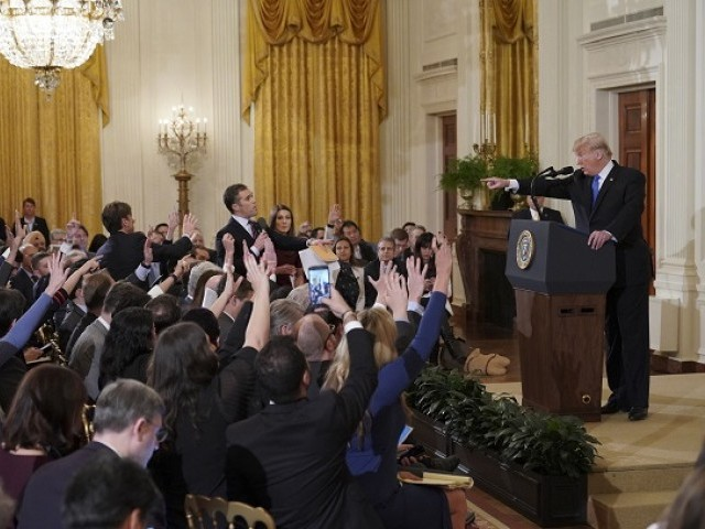 US President Donald Trump points to journalist Jim Acosta from CNN during a post-election press conference in the East Room of the White House in Washington DC