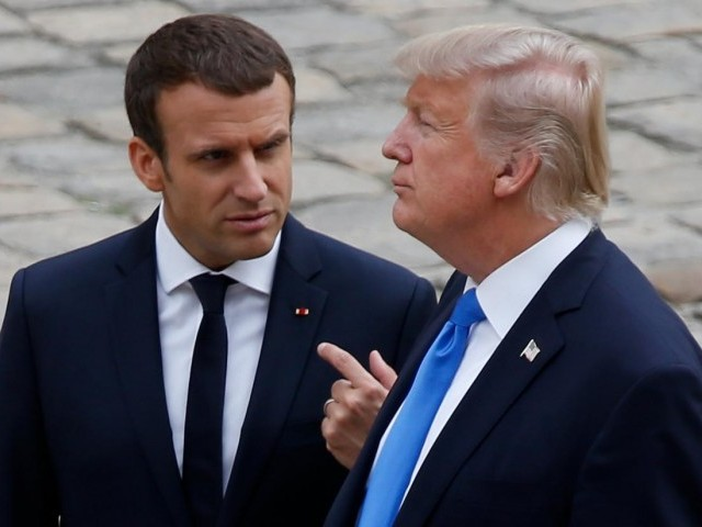 In Paris, Trump walks alone as French president rips nationalism