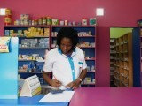 a-vendor-writes-as-she-stands-in-a-legal-pharmacy-in-abidjan