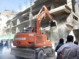 Karachi Metropolitan Corporation's anti encroachment team demolishes a newly constructed building at Empress Market, Saddar. PHOTO: EXPRESS