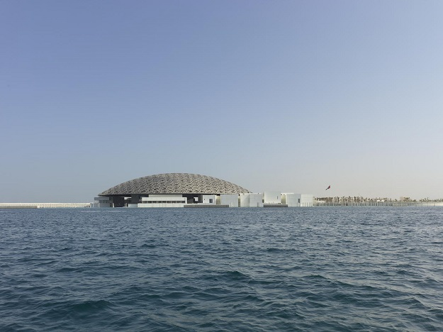 Daylight view of the museum from the sea. PHOTO: ROLAND HALBE via LOUVRE ABU DHABI