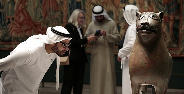 Mohamed Khalifa Al Mubarak, Chairman of the Abu Dhabi Department of Culture and Tourism looks at the Monumental Lion sculpture at the Louvre Abu Dhabi Museum in Abu Dhabi, United Arab Emirates. PHOTO: REUTERS