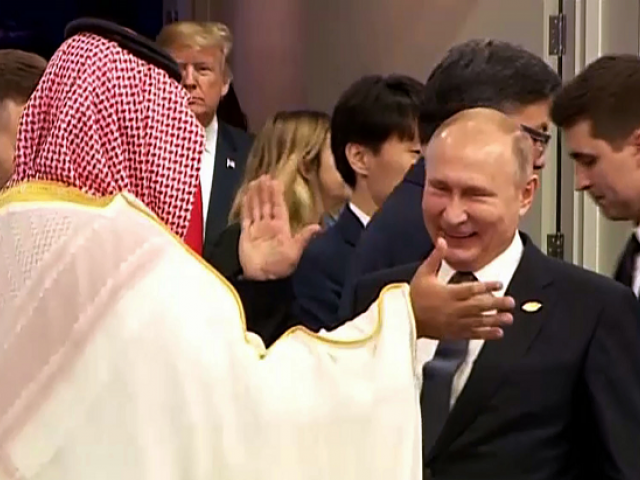 Russia's President Vladimir Putin and Saudi Arabia's Crown Prince Mohammed bin Salman greet each other at the G20 Leaders&#039 Summit in Buenos Aires
