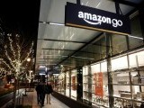 people-walk-by-the-amazon-go-brick-and-mortar-grocery-store-without-lines-or-checkout-counters-in-seattle-washington-2