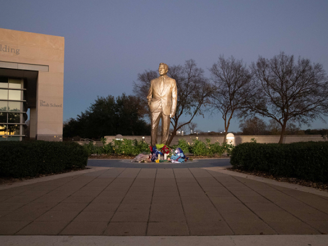 Flowers laid are seen at the base of the statue at the George Bush Presidential Library in College Station Texas
