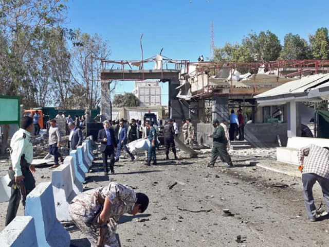 A general view of the scene of a car bombing in front of a police station in the city of Chabahar