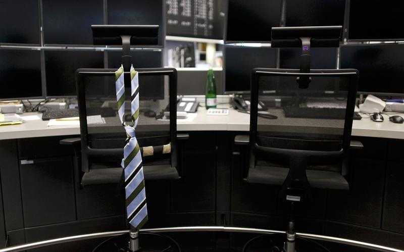 A tie hangs from an empty chair on a desk. PHOTO: REUTERS