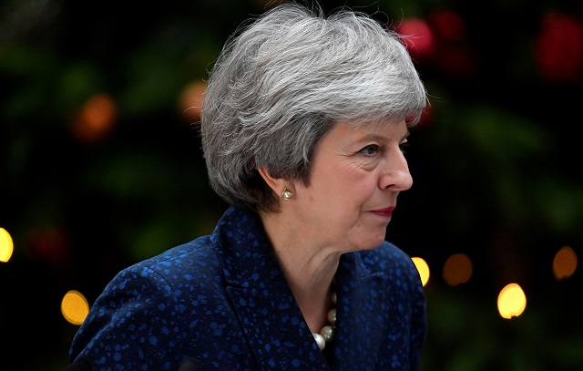 Britain's Prime Minister Theresa May addresses the media outside 10 Downing Street after it was announced that the Conservative Party will hold a vote of no confidence in her leadership, in London, Britain, December 12, 2018. PHOTO:REUTERS