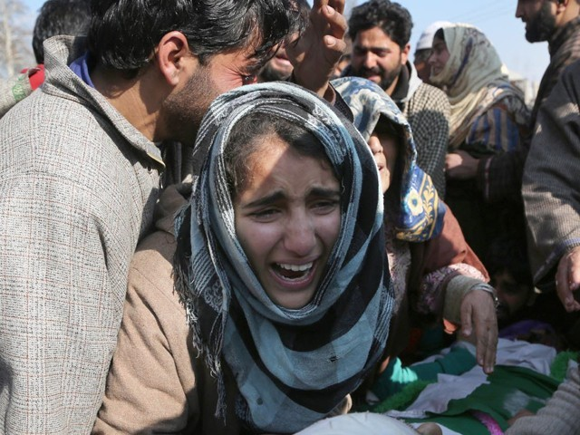 A girl is crying at funeral of her loved one in Indian-occuoied Kashmir's Pulwama district on Saturday. PHOTO: XINHUA/INP