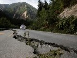 A crack runs through a mountain road. PHOTO: REUTERS