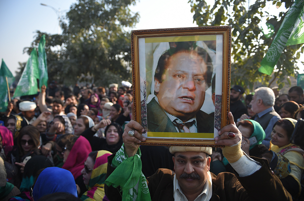 Supporters of former prime minister Nawaz Sharif gather outside the anti-corruption court in Islamabad. PHOTO: AFP