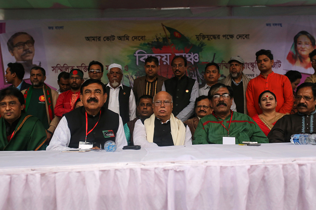 This photo taken on December 16, 2018 shows leaders of the ruling Bangladesh Awami League including Health Minister Mohammad Nasim (C) and Shipping Minister Shahjahan Khan (2nd L) at a rally during the general election campaign in Dhaka. PHOTO: AFP