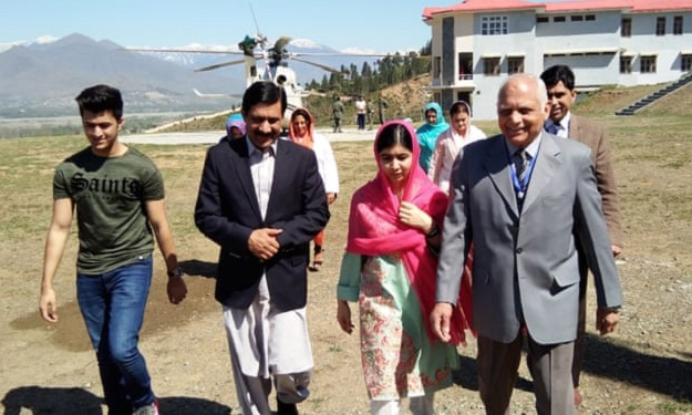 Malala Yousafzai and her father, Ziauddin, during her visit to Pakistan. PHOTO: AFP