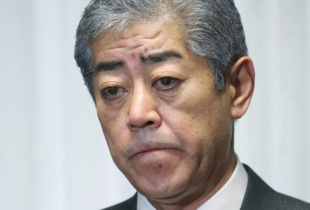 Japanese Defence Minister Takeshi Iwaya delivers a statement during his Q and A session with journalists following a US military aircraft crash at the parliament in Tokyo