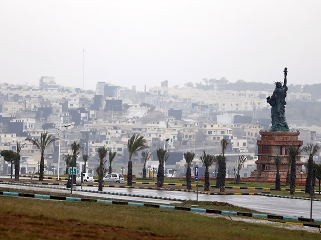 A replica of the Statue of Liberty stands on a hill overlooking the construction of new homes in Bahria Town on the outskirts of Islamabad. Photo: Reuters