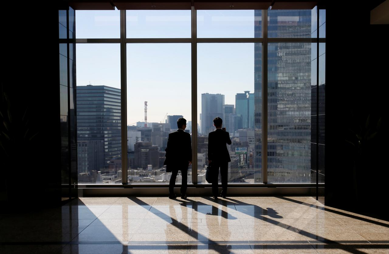 file-photo-businessmen-are-seen-inside-a-high-rise-office-building-in-tokyo-3-2-2-2-2