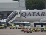 qatar-airways-passengers-disembark-2-3-2-2-2