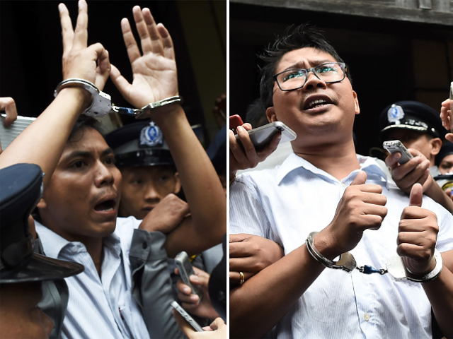 This combo file photo taken on September 03, 2018 shows journalists Kyaw Soe Oo (L) and Wa Lone (R) being escorted by police after their sentencing by a court to jail in Yangon on September 3, 2018. PHOTO: AFP